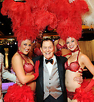 Al Weatherhead with some of the showgirls at the 2010 Circle of Life Gala benefitting Pediatric and Adult Centers of Excellence in Neurosciences at the Hilton Americas Houston Saturday May 08,2010.  (Dave Rossman Photo)