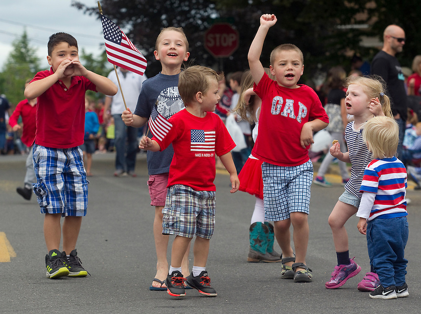 """Neoghborhood kids chant """"USA, USA"""" as they await the start of the Fourth of July Parade through the town of Ridgefield Monday July 4, 2016. (Photo by Natalie Behring/ for the The Columbian)"""