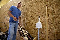Brandon Nimmo shows a box full of broken bats during a tour of his family's 2688 sq. ft. barn that houses a batting cage on Tuesday, June 21, 2011, in Cheyenne, Wyo. The New York Mets selected Nimmo No. 13 overall in the first round of this year's MLB draft. Now the recent high school grad must decide whether to go pro or accept an offer to play baseball at Arkansas in the fall. (Photo by James Brosher)
