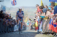 Dimitri Claeys (BEL/Wanty-Groupe Gobert) is the first rider over the Oude Kwaremont on the 2nd (of 3) passage. <br /> He would eventually finish 9th in his very first Ronde just 1 week after the fatal accident of his teammate Antoine Demoitié in Gent-Wevelgem.<br /> <br /> 100th Ronde van Vlaanderen 2016