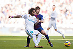 Marcelo Vieira Da Silva (L) of Real Madrid fights for the ball with Sergi Roberto Carnicer of FC Barcelona during the La Liga 2017-18 match between Real Madrid and FC Barcelona at Santiago Bernabeu Stadium on December 23 2017 in Madrid, Spain. Photo by Diego Gonzalez / Power Sport Images