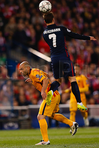13.04.2016. Madrid, Spain.  Antonie Griezmann (7) Atletico de Madrid andJavier Alejandro Macherano (14) FC Barcelona. UCL Champions League between Atletico de Madrid and FC Barcelona at the Vicente Calderon stadium in Madrid, Spain, April 13, 2016 .
