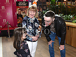Keith Barry does a card trick for Leah Devine and her mam Carol at the official opening of Abrakebabra and O'Briens in Scotch Hall. Photo:Colin Bell/pressphotos.ie