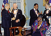 "The recipients of the 16th Annual Kennedy Center Honors share an informal moment as they pose for a group photo following a dinner at the United States Department of State in Washington, D.C. on Saturday, December 4, 1993.  From left to right: conductor Georg Solti, former ""Tonight Show"" host Johnny Carson, Arthur Mitchell, founder of the Dance Theatre of Harlem, gospel singer Marion Williams and and composer and lyricist Stephen Sondheim.  The 1993 honorees are: Johnny Carson, Arthur Mitchell, Georg Solti Stephen Sondheim and Marion Williams.<br /> Credit: Greg E. Mathieson / Pool via CNP"
