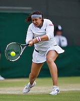 02-07-13, England, London,  AELTC, Wimbledon, Tennis, Wimbledon 2013, Day eight, Marion Bartoli (FRA)<br /> <br /> <br /> <br /> Photo: Henk Koster