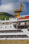 A multistoried PELNI ship, nearly eclipsing the view Gunung Api volcano, appears like a skyscaper on the skyline of sleepy Banda Neira.