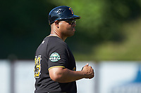 Bristol Pirates manager Miguel Perez (28) coaches third base during the game against the Danville Braves at American Legion Post 325 Field on July 1, 2018 in Danville, Virginia. The Braves defeated the Pirates 3-2 in 10 innings. (Brian Westerholt/Four Seam Images)
