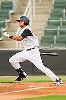Keenyn Walker #23 of the Kannapolis Intimidators follows through on his swing against the Lexington Legends at CMC-Northeast Stadium on May 18, 2012 in Kannapolis, North Carolina.  The Legends defeated the Intimidators 7-3.  (Brian Westerholt/Four Seam Images)