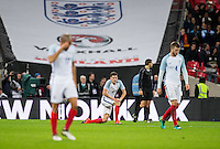 John Stones (Man City) of England drops to his knees after the second spain goal during the International Friendly match between England and Spain at Wembley Stadium, London, England on 15 November 2016. Photo by Andy Rowland.