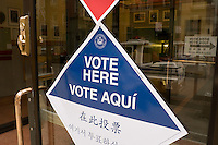 New York, NY - 4 November 2008 Multi lingual signs (english, spanish chinese, and korean) outside a New York City polling site.