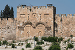 The Eastern Gate, the Golden Gate or the Gate of Mercy of the Old City of Jerusalem with the Temple Mount or al-Haram ash-Sharif behind it.  In front is a Muslim cemetery.  The Old City of Jerusalem and its Walls is a UNESCO World Heritage Site.  This gate has been walled up since the 1500's.