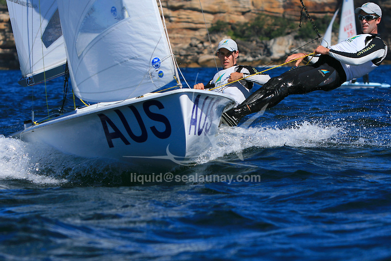 """Beijin 2008 gold medalist Malcolm Page and Mathew Belcher training in Sydney Harbour by a Westerly breeze  on a sunny day for the world championship before heading to Europe...THE 470 DINGHY The 470 is an Olympic class dinghy recognised by ISAF, sailed by both male and female teams. It was designed in 1963 by the frenchman André Cornu, as a modern fiberglass planing dinghy. In 1969 the class was given international status and it has been an olympic class since featuring at the Montreal Olympics in 1976. In 1988 the first olympic womens sailing event was sailed in the 470..the 470 is sailed in more than 61 nations around the world..The boat is equipped with spinnaker and trapeze, which demands real teamwork. To be competitive, everything should be mastered to perfection and the 470 is often quoted as the hardest Olympic design to get to grips with. Tactically the boat is demanding as speed differences between competitors are small and fleets are usually big..To sail the 470, good physical health is enough; strength is not crucial. The competitive crew weight is 110 - 145 kg, making it ideal for both women and men..PARTICULARS.Length: 4.7m, 15'5"""".Length of waterline: 4.4m, 14'6"""".Mass: 120kg, 264lbs..Mast: 6.76m, 22'3"""".Total Sail Area: 12.7m^2, 137ft^2.Jib: 3.58m^2, 39ft^2.Main: 9.12m^2, 98ft^2.Spinnaker: 13m^2, 140ft^2.Crew .Two (single trapeze).Olympic Class..Malcolm Page (born 22 March 1972) is an Australian sailor. He was educated at St. Andrew's Cathedral School in Sydney. He and team mate Nathan Wilmot have won five world titles in the 470 class. They also won the Olympic test event in Qingdao in 2007 and were considered favourites to win the 470 event at the 2008 Summer Olympics, which they did...Mathew Belcher ..25.Nationality/Country.Australian/New Zealand.Being a natural sportsman, it no accident that Queenslander Mat Belcher is where he is today - campaigning for the 2008 Olympic Games. However Mat's first foray into sailing gave no indication of the talent"""