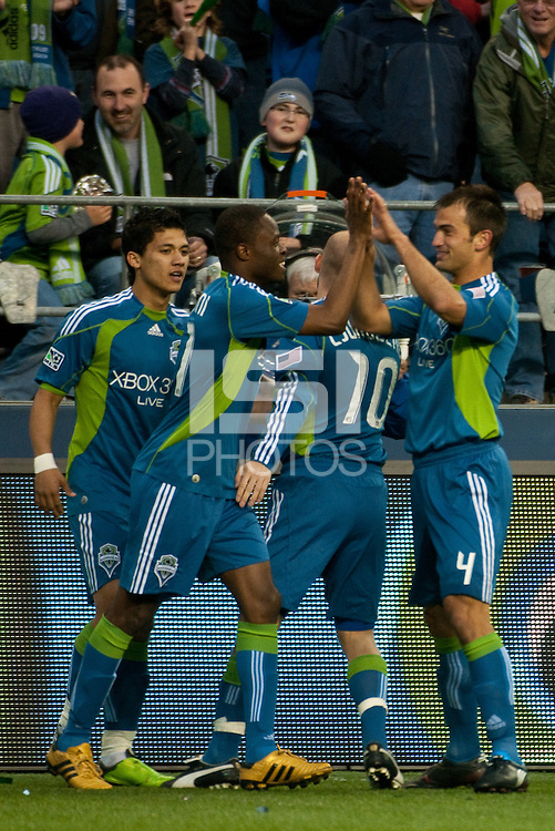 Steve Zakuani (second left) of the Seattle Sounders celebrates with teammates Fredy Montero(l), Freddie Ljungberg (third left) and Patrick Ianni (r) after scoring the first goal of the game against the Columbus Crew at the XBox 360 Pitch at Quest Field in Seattle, WA on May 1, 2010. the Sounders and Crew played to a 1-1 draw.