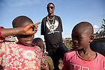 Kibera born Kenyan hip-hop artist Octopizzo offers tours of Kibera focused on the positive side of life in the slum. He highlights creativity, industry and resourceful problem solving of the people who make the slum home.