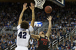 San Diego State guard Malachi Flynn (22) lays the ball up      shoots over the out stretched arms of Nevada forward K.J. Hymes (42) during the second half of a basketball game played at Lawlor Events Center in Reno, Nev., Saturday, Feb. 29, 2020. (AP Photo/Tom R. Smedes)