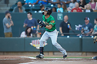 Anderson Tejeda (2) of the Down East Wood Ducks follows through on his swing against the Winston-Salem Dash at BB&T Ballpark on May 10, 2019 in Winston-Salem, North Carolina. The Wood Ducks defeated the Dash 9-2. (Brian Westerholt/Four Seam Images)