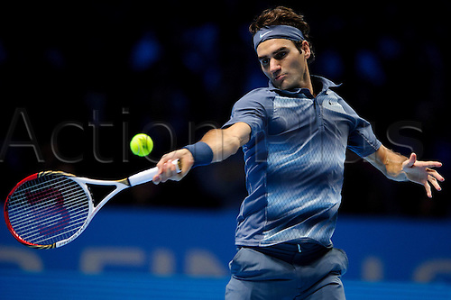 10.11.2013 London, England. Roger Federer of Switzerland (SUI) in action in his men's singles Semi Final match against Rafael Nadal of Spain (ESP) during day seven of the Barclays ATP World Tour Finals at The O2 Arena.
