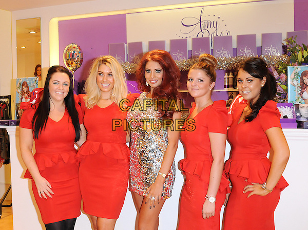Amy Childs .Opens Her New Clothes Boutique At Eastgate Shopping Centre, Basildon, Essex, UK, 1st December 2012..half length dress mini silver sequined sequin staff girls red dresses peplum .CAP/BRC.©Ben Rector/Capital Pictures.