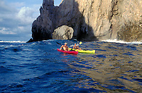 Mexico, Baja California, Cabo San Lucas, couple kayaking off The Arch.