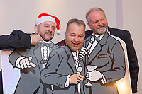 Pictured: Nigel Willett (L) from Caerphilly with two other lotto millionaires. Wednesday 28 November 2018<br /> Re: National Lottery millionaires from south Wales and the south west of England have hosted a glitzy Rat Pack-inspired Christmas party for an older people's music group at The Bear Hotel in Cowbridge, Wales, UK.
