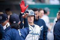 Columbus Clippers right fielder Trayce Thompson (24) is congratulated by teammates after hitting a home run during an International League game against the Indianapolis Indians on April 30, 2019 at Victory Field in Indianapolis, Indiana. Columbus defeated Indianapolis 7-6. (Zachary Lucy/Four Seam Images)