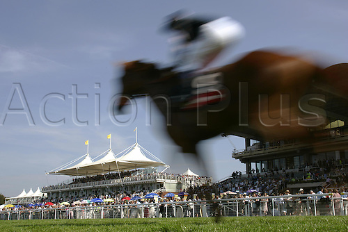30 July 2004: Effect shot of a horse running in front of the Grandstand at Goodwood Photo: Glyn Kirk/Action Plus...horse racing 040730 blur effects movement speed