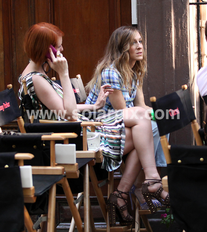 "**ALL ROUND PICTURES FROM SOLARPIX.COM**.**SYNDICATION RIGHTS FOR UK, AUSTRALIA, DENMARK, PORTUGAL, S. AFRICA, SPAIN & DUBAI (U.A.E) ONLY**.""Sex and the City 2"" Filming in Greenwich Village in New York USA..This pic:Sarah Jessica Parker & Cynthia Nixon..JOB REF:9883     PHZ/Mayer    DATE: 04.09.09.**MUST CREDIT SOLARPIX.COM OR DOUBLE FEE WILL BE CHARGED**.**MUST NOTIFY SOLARPIX OF ONLINE USAGE**.**CALL US ON: +34 952 811 768 or LOW RATE FROM UK 0844 617 7637**"