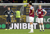 Burnley's Nick Pope (left) Jack Cork and Ben Mee look dejected after Crystal Palace's Jeffrey Schlupp scored his sides second goal<br /> <br /> Photographer Rich Linley/CameraSport<br /> <br /> The Premier League - Burnley v Crystal Palace - Saturday 30th November 2019 - Turf Moor - Burnley<br /> <br /> World Copyright © 2019 CameraSport. All rights reserved. 43 Linden Ave. Countesthorpe. Leicester. England. LE8 5PG - Tel: +44 (0) 116 277 4147 - admin@camerasport.com - www.camerasport.com