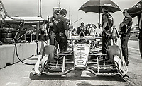 ELKHART LAKE, WI - June 23, 2017: (EDITOR'S NOTE: Photo taken on 35mm black and white film with vintage 35mm rangefinder camera) Helio Castroneves sits in his car before the Kohler Grand Prix Verizon IndyCar race at Road America on June 23, 2017 in Elkhart Lake, Wisconsin. (Photo by Brian Cleary/BCPix.com)