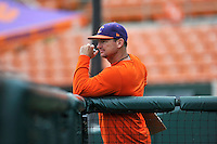 First-year head coach Monte Lee (18) of the Clemson Tigers watches his team in a fall practice intra-squad Orange-Purple scrimmage on Sunday, September 27, 2015, at Doug Kingsmore Stadium in Clemson, South Carolina. (Tom Priddy/Four Seam Images)