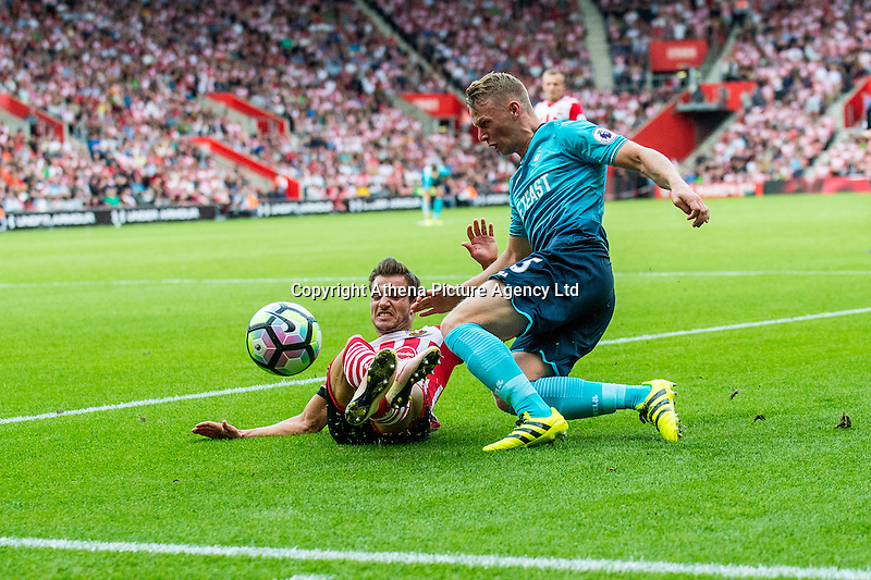 Cedric Soares of Southampton tackles Stephen Kingsley of Swansea City  during the Premier League match between Southampton and Swansea City  at St Mary's Stadium in Southampton, England, UK. Saturday 17 September 2016