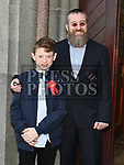 Oisin DeBruín who was confirmed in St Mary's church pictured with his dad Chris. Photo:Colin Bell/pressphotos.ie