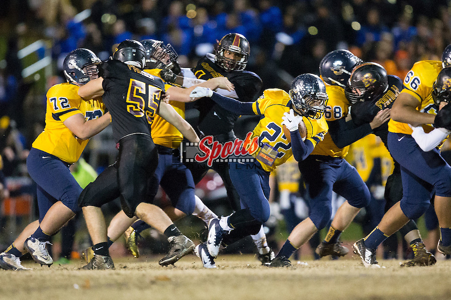 Tyree Hallman (22) of the South Iredell Vikings runs with the football during first half action against the JM Robinson Bulldogs at South Iredell High School November 20, 2015, in Statesville, North Carolina.  The Vikings defeated the Bulldogs 14-13.  (Brian Westerholt/Special to the Tribune)