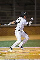 Keegan Maronpot (13) of the Wake Forest Demon Deacons follows through on his swing against the Georgetown Hoyas at David F. Couch Ballpark on February 19, 2016 in Winston-Salem, North Carolina.  The Demon Deacons defeated the Hoyas 3-1.  (Brian Westerholt/Four Seam Images)