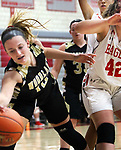 WOLCOTT CT. 10 December 2018-121018SV04-#10 Gabby Mastropietro of Woodland High tries to save the ball from going out of bounds as #42 Adriana Ferruci of Wolcott High defends during NVL basketball action in Wolcott Monday.<br /> Steven Valenti Republican-American