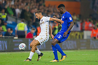 Liam Cooper of Leeds United  and Bruno Manga of Cardiff City during the Sky Bet Championship match between Cardiff City and Leeds United at the Cardiff City Stadium, Cardiff, Wales on 26 September 2017. Photo by Mark  Hawkins / PRiME Media Images.