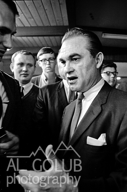 Modesto, California November 22, 1967.Modesto Bee reporter ask Wallace questions..Former Alabama Governor George Wallace came to California in an attempt to put his American Independent Party candidacy on the 1968 ballot.  In Modesto his appearance was held at the Sandpiper Steak House on McHenry Ave.  The Governor's entourage was 25 or so people.   Thirteen of the staff were Alabama State Police and the others were campaign workers including several lawyers and one Judge.  .