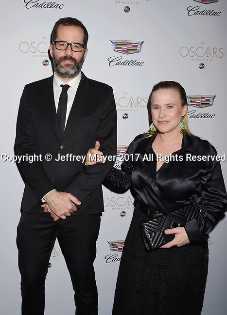 LOS ANGELES, CA - FEBRUARY 23: Artist Eric White (L) and actress Patricia Arquette attend Cadillac's 89th annual Academy Awards celebration at Chateau Marmont on February 23, 2017 in Los Angeles, California.