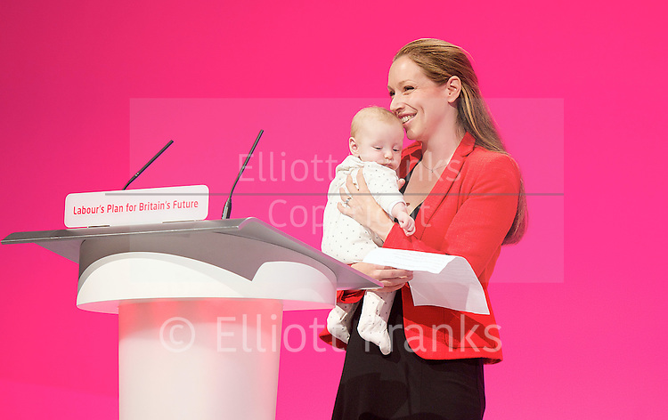 Labour Party Conference<br /> at Manchester Central, Manchester, Great Britain <br /> 24th September 2014 <br /> <br /> Catherine Atkinson with her 3 month old baby Jacob <br /> speaking in the Health &amp; Care debate <br /> PPC for Erewash <br /> <br /> Photograph by Elliott Franks <br /> Image licensed to Elliott Franks Photography Services