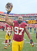 Washington Redskins defensive end Jason Hatcher (97) celebrates as he leaves the field following the game against Buffalo Bills against the Washington Redskins at FedEx Field in Landover, Maryland on Sunday, December 20, 2015.  The Redskins won the game 35-25.<br /> Credit: Ron Sachs / CNP