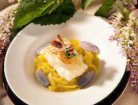 Plated Haddock with shrimp, curried onions and purple potatos.