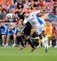 Chris Pontius (13) of D.C. United goes up for a header with Steven Beitashour (33) of the San Jose Earthquakes during the game at RFK Stadium in Washington, DC.  D.C. United was defeated by the San Jose Earthquakes, 4-2.