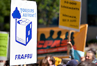 A FRAPRU sign is seen during an anti-poverty protest in front of the Congress Center in Quebec city June 15, 2009. The FRAPRU, FRont d'Action Populaire en Reamenagement Urbain, was created in 1978 to fight for poor people and the cration of social housing.
