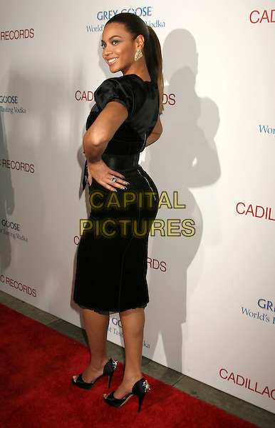 "BEYONCE KNOWLES .""Cadillac Records"" Los Angeles Premiere held at Grauman's Egyptian Theatre, Hollywood, California, USA..November 24th, 2008.full length black dress silk satin puffball sleeves gold hands on hips back behind rear .CAP/ADM/MJ.©Michael Jade/AdMedia/Capital Pictures."