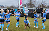Nancy May Turner (Ex on the Beach) keeps teammates including George Harrison (right) (TOWIE) entertained with cartwheels during the SOCCER SIX Celebrity Football Event at the Queen Elizabeth Olympic Park, London, England on 26 March 2016. Photo by Kevin Prescod.