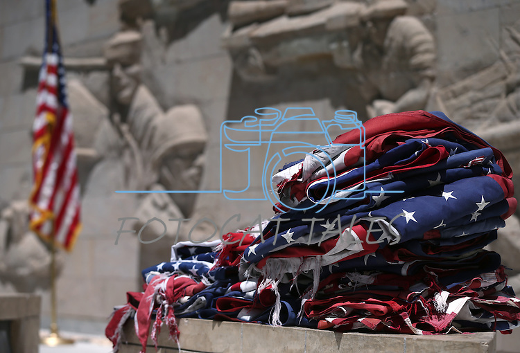 A pile of tattererd flags await the flag retirement ceremony at the Nevada State Veteran's Memorial at the Capitol, in Carson City, Nev., on Friday, June 27, 2014. The American Legion Carson City Post 4 and members of Boys State hold the annual event.<br /> Photo by Cathleen Allison