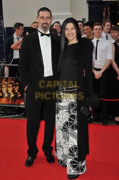 MATTHEW FOX & MARGHERITA RONCHI .Attending The Laurence Olivier Awards, .Theatre Royal, Drury Lane, London.England, UK, March 13th 2011..arrivals full length couple husband wife black and white print  skirt coat tuxedo tux bow tie fur trim trimmed belt .CAP/CAS.©Bob Cass/Capital Pictures.
