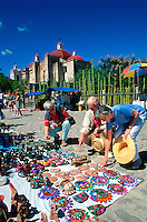 Tourism couple shopping in the town of Mitla, Mexico