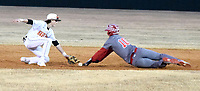 Westside Eagle Observer/MIKE ECKELS<br /> <br /> Lion Keegan Bulza (left) goes after the ball as Bulldog runner slides toward second base during the Gravette-Grove, Okla. baseball game in Gravette Friday night.