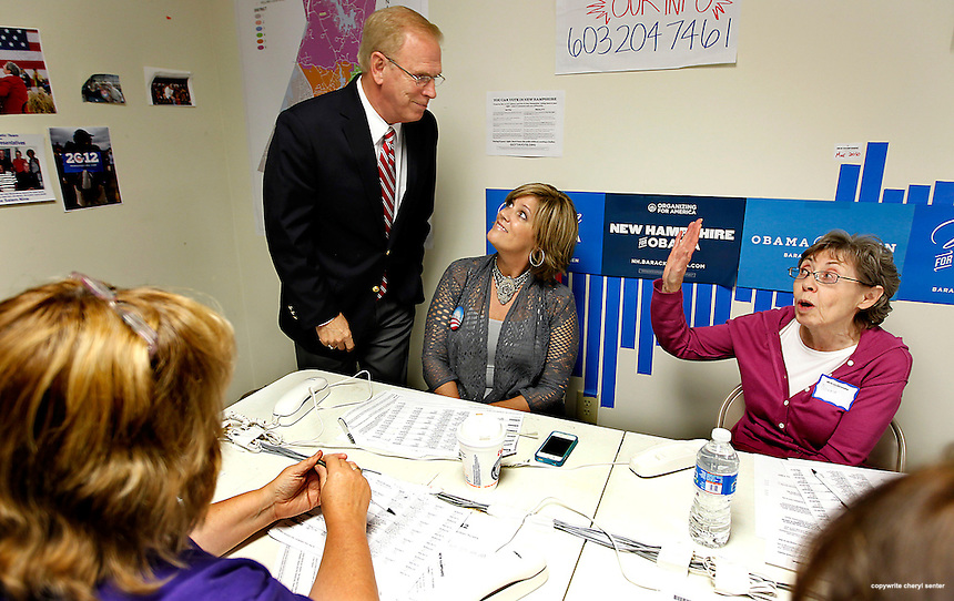 Former Ohio Gov Ted Strickland, left, campaigning in NH for Obama, jokes with volunteers, Michele Brown, center, and Donna Warren, right, while visiting a phone bank in Salem, N.H.,  Thursday, Sept. 27, 2012. (Cheryl Senter for the Boston Globe)
